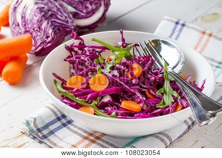 Red cabbage salad with carrot and arugula