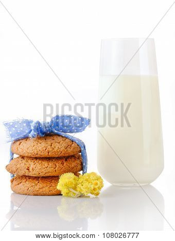 Stack of three homemade oatmeal cookies tied with blue ribbon in small white polka dots tiny yellow
