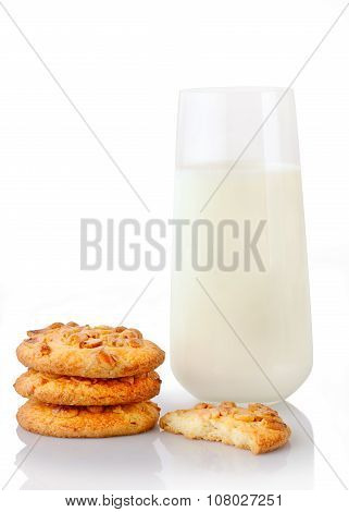 Stack of three homemade peanut butter cookies half of cookie and glass of milk