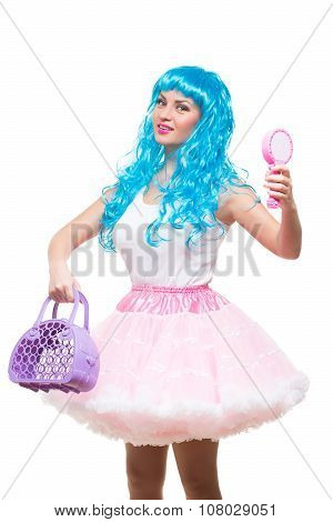 young girl doll with blue hair. holding a mirror and handbag