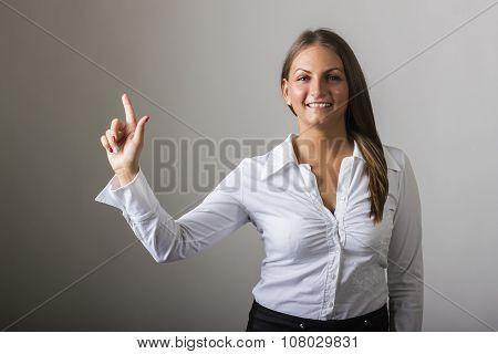 Beautiful Girl Touching Transparent Surface