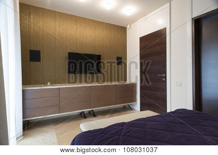 Bedroom Interior With Wall Mounted Tv And Speakers