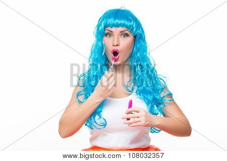 young girl doll with blue hair. lipstick