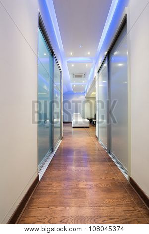 Long Corridor In Luxury Apartment With Colorful Ceiling Lights