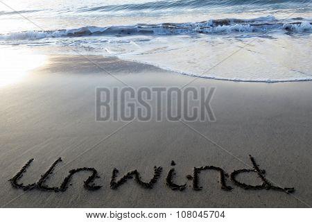 Unwind written in sand