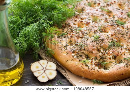 Homemade focaccia with dill, garlic and olive oil