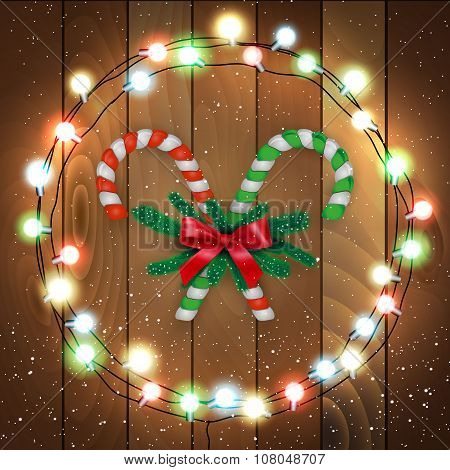 Merry Christmas candy with branches wooden bg