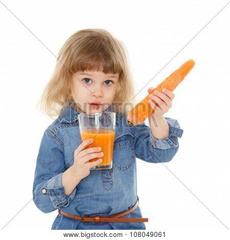 Little Child Drinks Carrot Juice.