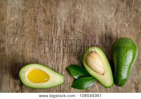 Fresh Avocado And  Avocado Like A Bowl For Oil On Wooden Background
