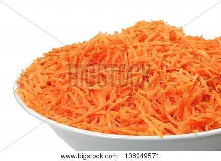 Raw Grated Carrots On A Plate