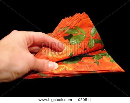 Red Napkins On Black Background In A Hand