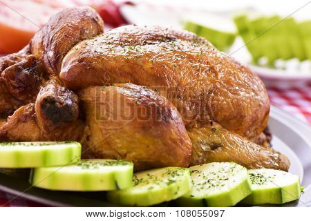 closeup of an appetizing roast turkey in a tray with vegetables