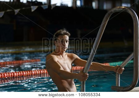 Portrait of a handsome man swimming pool