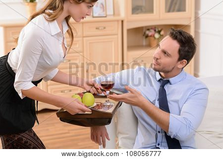 Attractive housemaid flirting with man