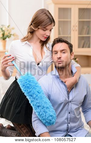 Handsome man commiting betrayal with housemaid