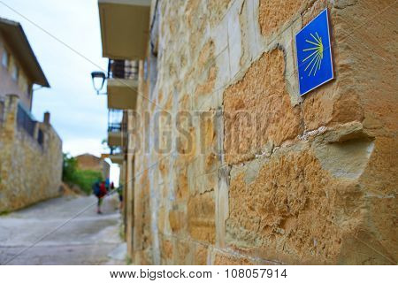 The Way of Saint James shell sign in Navarra stonewall Spain