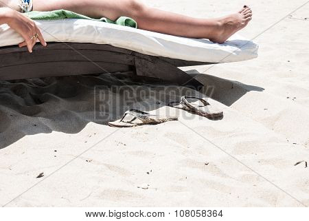 Leg girl on a beach lounger