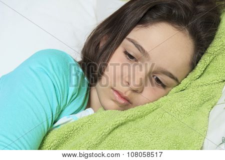 Young sad woman bed