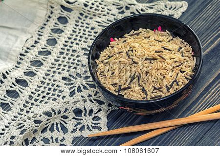 Unpolished Rice On Wooden Background