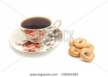 Heap Of Bagels And Cup Of Tea On White