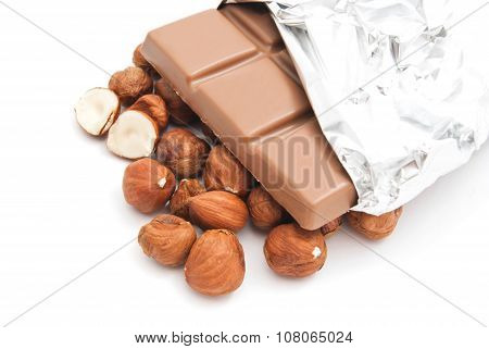 Hazelnuts And Chocolate On White