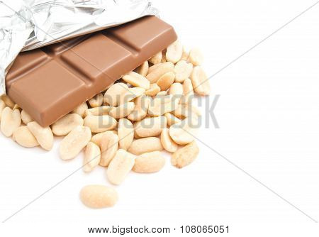 Chocolate And Some Peanuts On White