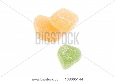 Three Sweet Fruit Candies On White