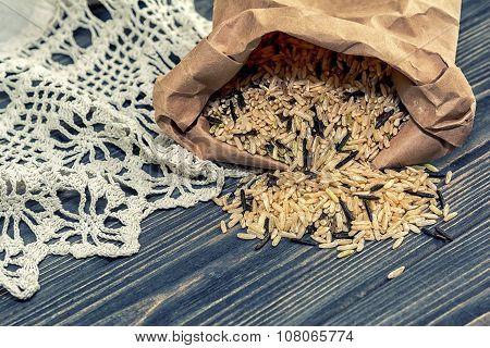Unpolished Rice On Wooden Background
