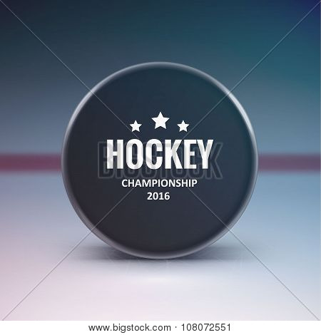 Hockey puck isolated on ice with blur