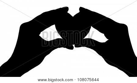 Silhouettes of hands with heart, isolated on white