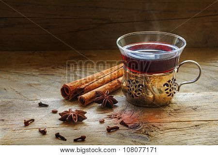 Mulled Wine, Christmas Punch With Spices On Rustic Wood