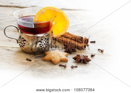 Mulled Wine, Christmas Punch With Orange Slice And Spices On Rustic Light Wood, Corner Background