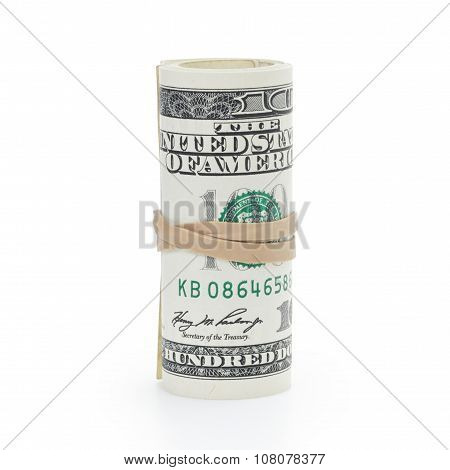 roll of 100 dollar banknotes tied with elastic band