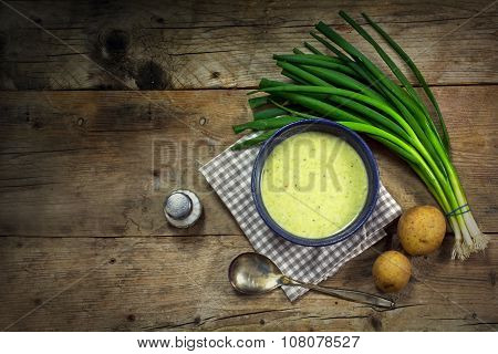 Cream Soup From Spring Onions, Leeks And Potatoes On Rustic Wood