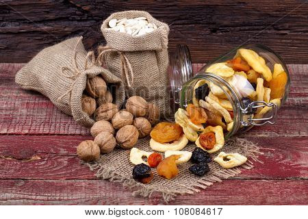 Dried Fruits, Nuts And Seeds Of Pumpkin On A Table