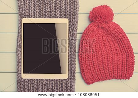 Tablet and winter clothes.