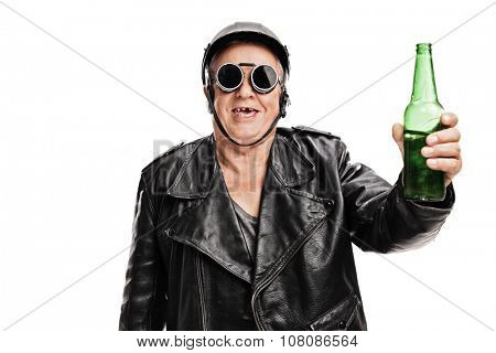 Toothless senior motorcyclist in black leather jacket and goggles holding a bottle of beer and looking at the camera isolated on white background