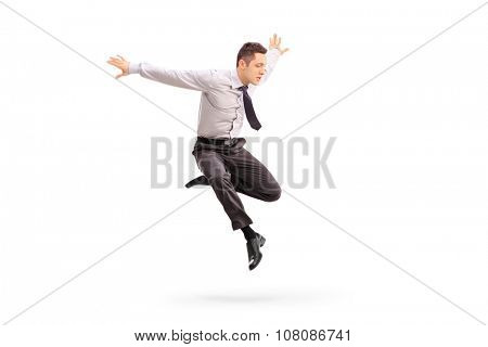 Studio shot of a young businessman jumping in the air isolated on white background