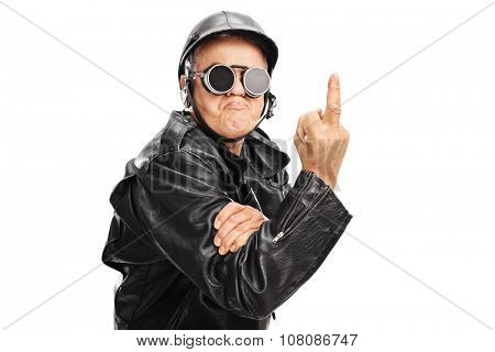 Angry senior biker with black goggles and helmet showing a middle finger towards the camera isolated on white background