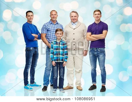 male, gender, generation and people concept - group of smiling men and boy over blue holidays lights background