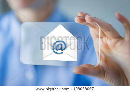 business, technology, communication and people concept - close up of woman hand holding and showing transparent smartphone with e-mail icon on screen