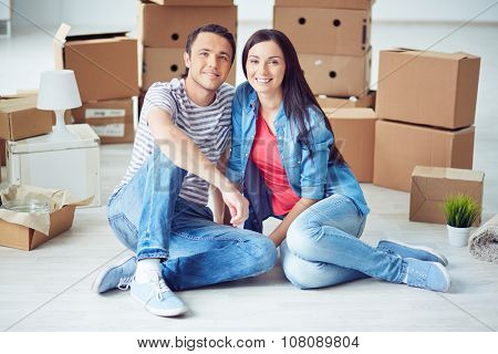 Portrait of young happy couple moving in new home