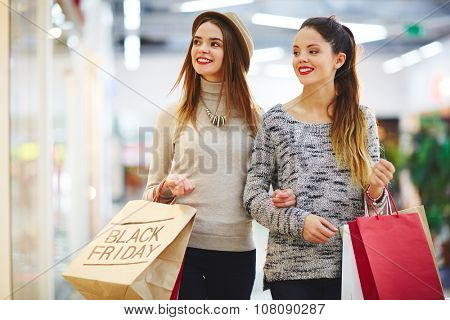 Two friendly girls on Black Friday sale