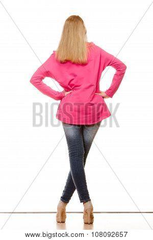 Woman In Denim Pants High Pink Shirt Back View
