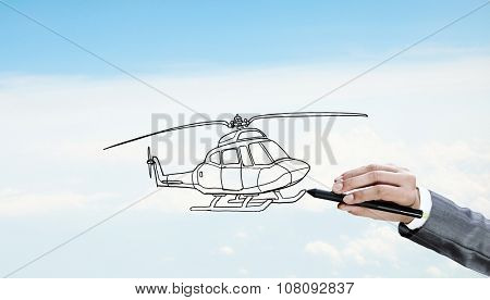 Hand drawing with stylus helicopter model on sky background