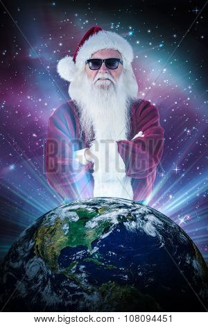Santa Claus wears black sunglasses against aurora shimmering in night sky