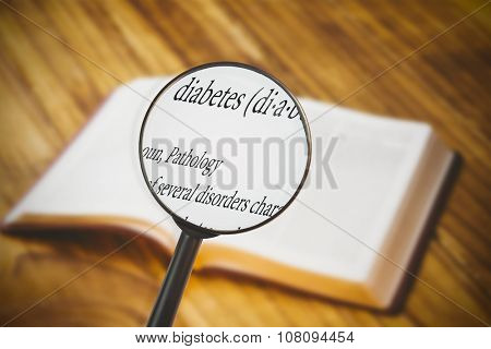 magnifying glass against bible on wooden flooring