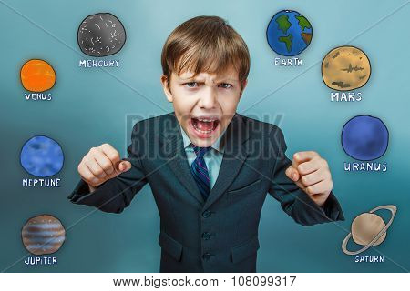 Teenage boy in a business style suit screaming and clenching his