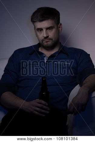 Miserable Man Drinking Beer