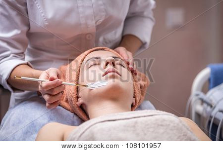 Young woman in spa salon.